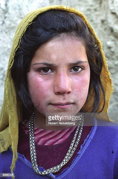 A girl from a farming family from Shomali plains area poses for a photograph November 25 2001 in Karabagh Afghanistan Their farms 30 miles north of...