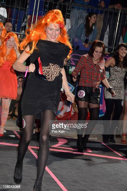 A girl from a High Heel Racing team attends the 'High Heel Race' Hosted by Sarenza Shoes at the Piscine Molitor on December 3 2010 in Paris France