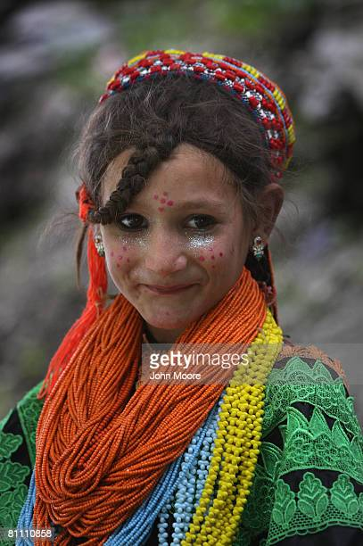 A girl from the polytheistic Kalash tribe watches the Joshi spring festival May 15 2008 in the remote Chitral village of Rumbur in northwestern...