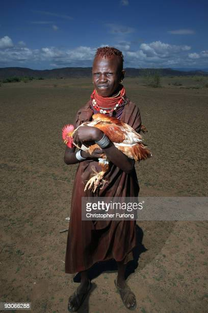A girl from the remote Turkana tribe in Northern Kenya tries to sell the family chicken to the photographer for 100 Kenyan shillings approxiametly...