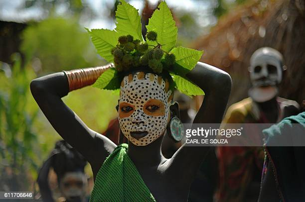 A girl from the Suri tribe pose in Ethiopia's southern Omo Valley region near Kibbish on September 25 2016 The Suri are a pastoralist Nilotic ethnic...