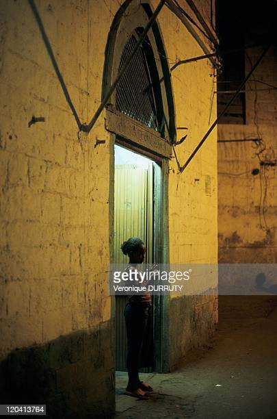 Girl front the door of her house on the old town of Massawa in Eritrea She was longtime the Pearl of the Red Sea Mythical city ideally situated on...