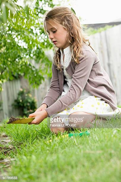 Girl gardening with a shovel
