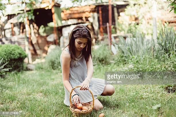 Girl gathering eggs