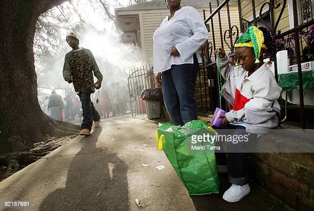 A girl gathers her beads during the Zulu parade a primarily AfricanAmerican parade during Mardi Gras festivities February 8 2005 in New Orleans...