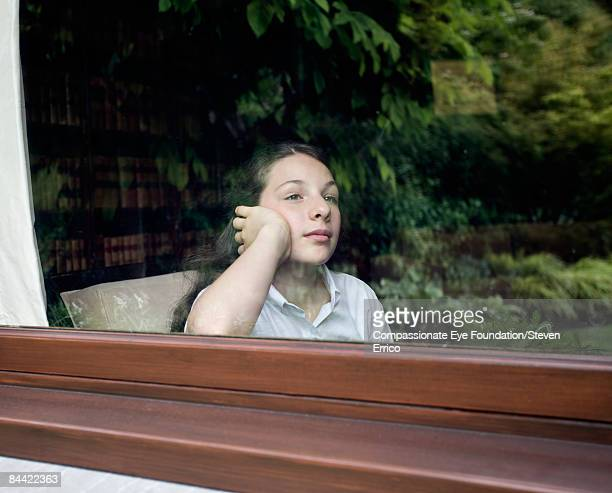 Girl gazing out of window