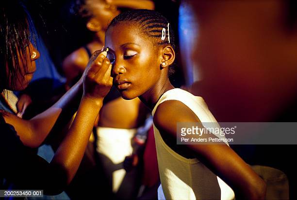 A girl gets a makeup backstage before a beauty competition in Soweto, South Africa