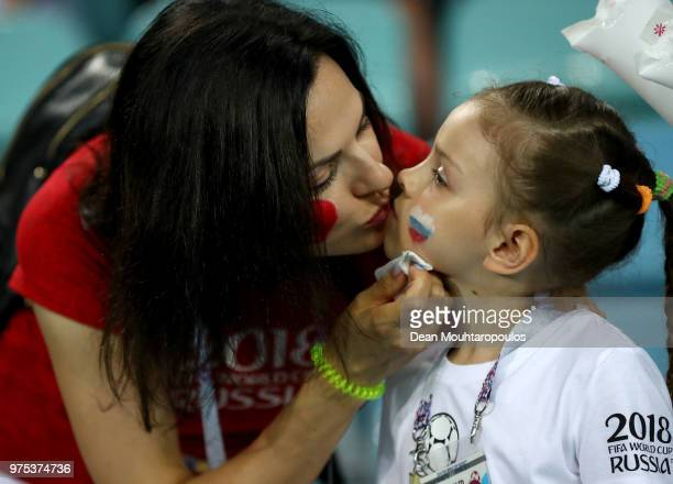A girl gets her face painted in the stands prior to the 2018 FIFA World Cup Russia group B match between Portugal and Spain at Fisht Stadium on June...