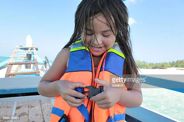 girl gets ready to snorkel in the sea - life jacket stock pictures, royalty-free photos & images