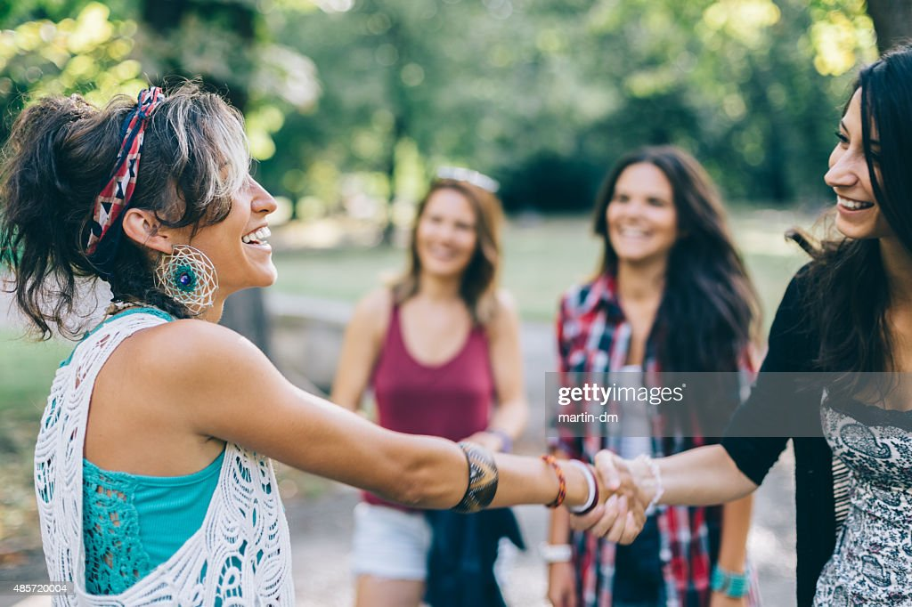 Girl getting acquainted to a new person : Stock Photo