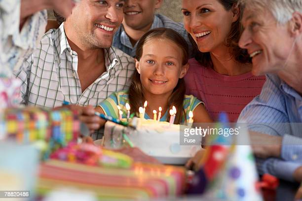 Girl Getting Cake At Birthday Party