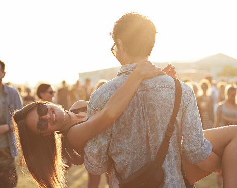 Girl getting carried by boyfrend at festival - gettyimageskorea