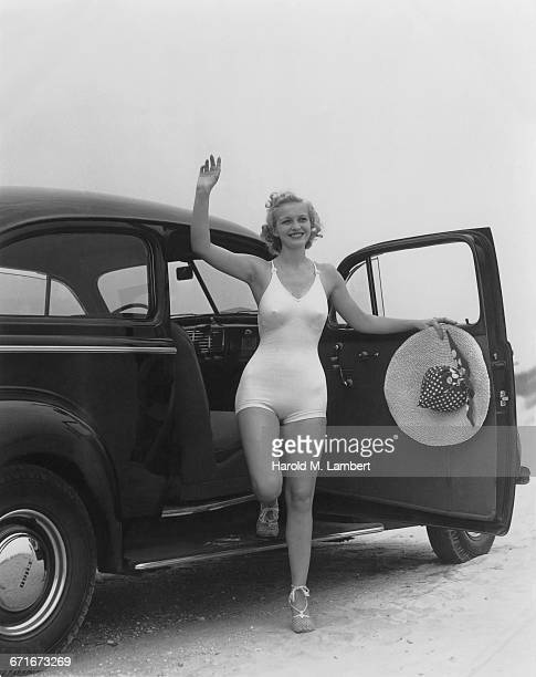 girl getting down of car and waving - {{relatedsearchurl(carousel.phrase)}} stock pictures, royalty-free photos & images