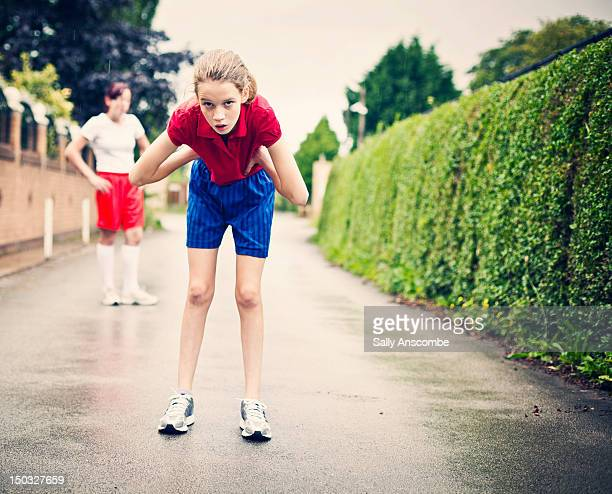 girl getting her breath back after run - running shorts stock pictures, royalty-free photos & images