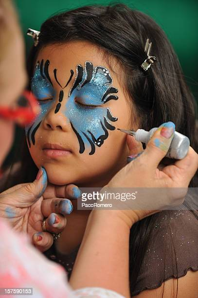Girl getting her face painted