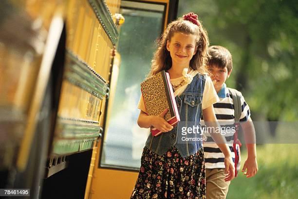 girl getting off school bus - 1990~1999年 ストックフォトと画像