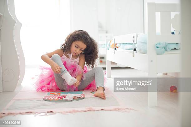 A girl getting ready for a dance class