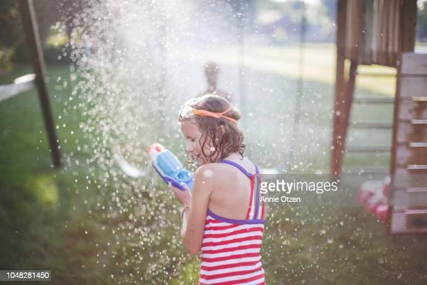 Girl Getting Sprayed By Sprinkler