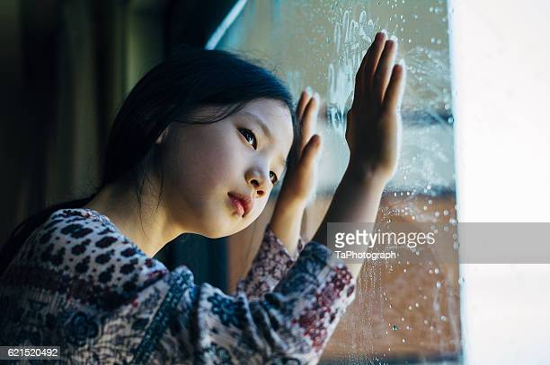 Girl getting thoughtful on a rainy day