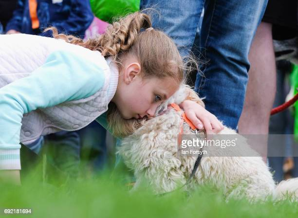 A girl giver her dog a cuddle as she takes part in the Great North Dog Walk on June 4 2017 in South Shields England Founded in 1990 by former teacher...