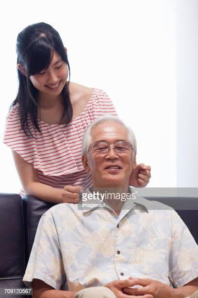 A girl giving a shoulder massage