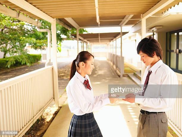 Girl Giving Boy Love Letter