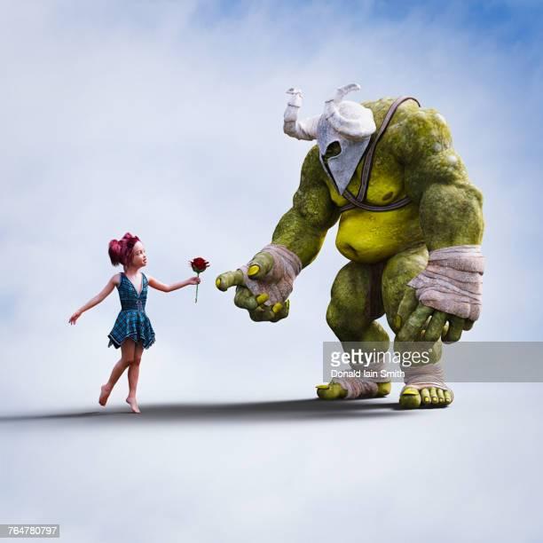 Girl giving flower to giant ogre