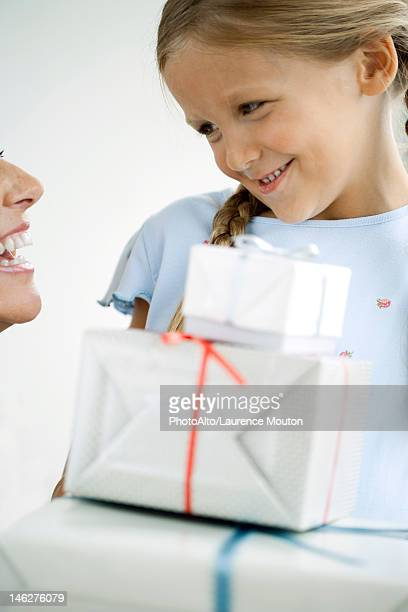 Girl giving her mother gifts