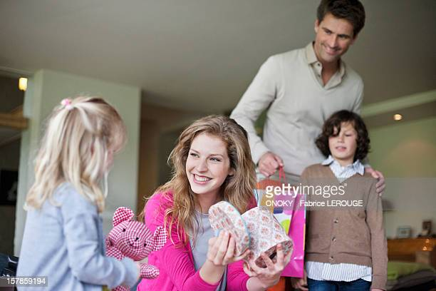 Girl giving surprise gift to her mother on mother day