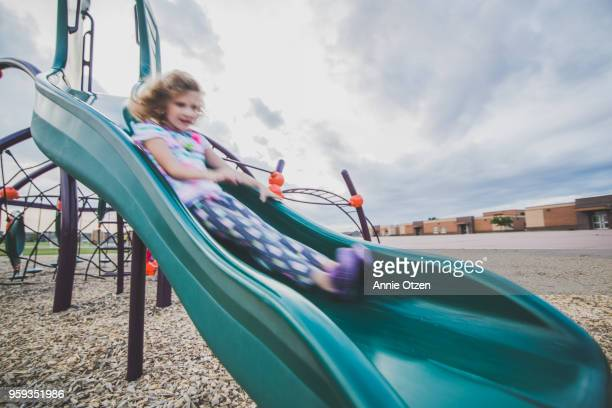 Girl going down a slide fast