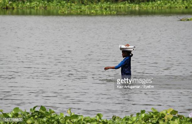 a girl going to school during flood - flood stock pictures, royalty-free photos & images