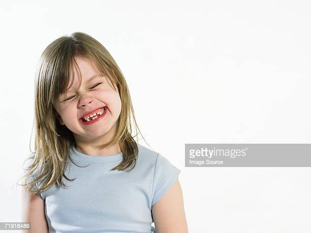 Girl grimacing
