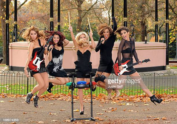 Girl Group The Saturdays Pose For Photographs To Celebrate The Uk Release Of 'Band Hero' The Latest Offering In The Successful 'Guitar Hero'...
