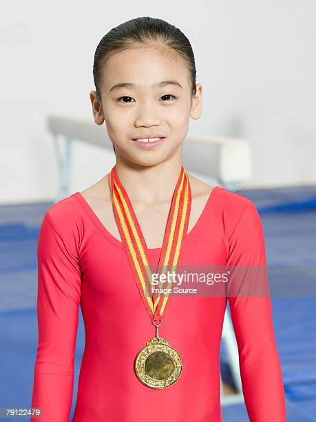 girl gymnast with medal - leotard stock pictures, royalty-free photos & images