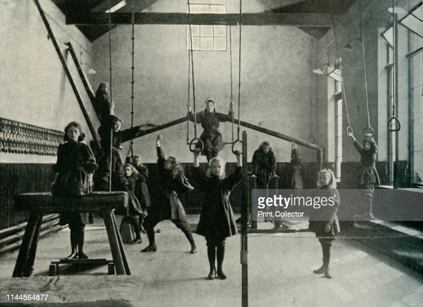 """Girl Gymnasts at the Royal Institution for the Deaf and Dumb, Friar Gate, Derby', 1902. From """"The Windsor Magazine Vol. XVI - June to November 1902""""...."""