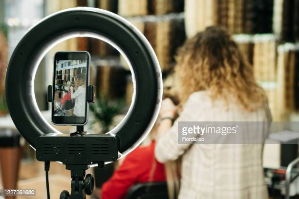 girl hairdresser doing hairstyle styling for a middle-aged woman in a beauty salon - backstage stock pictures, royalty-free photos & images