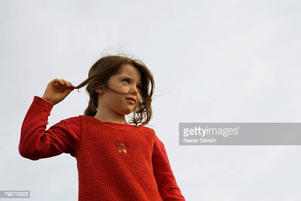 girl (7-9), hand in hair - girl chest stock photos and pictures