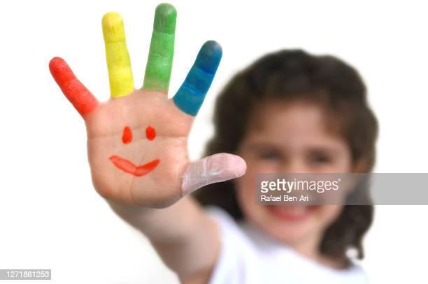 girl hand painted with many colors - rafael ben ari bildbanksfoton och bilder
