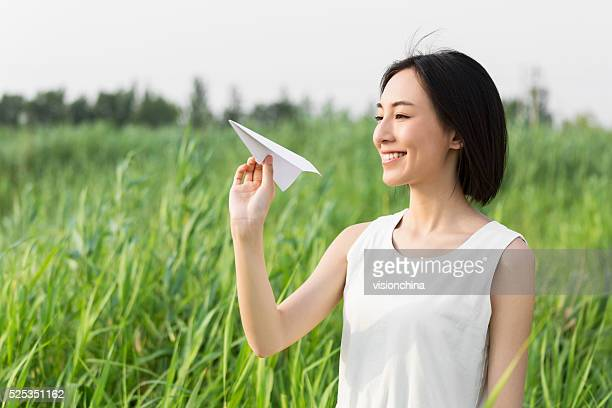 girl hands holding model airplane - beautiful chinese girls stock photos and pictures