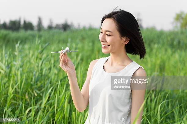 girl hands holding model airplane - beautiful asian girls stock photos and pictures