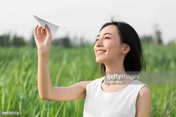 girl hands holding model airplane
