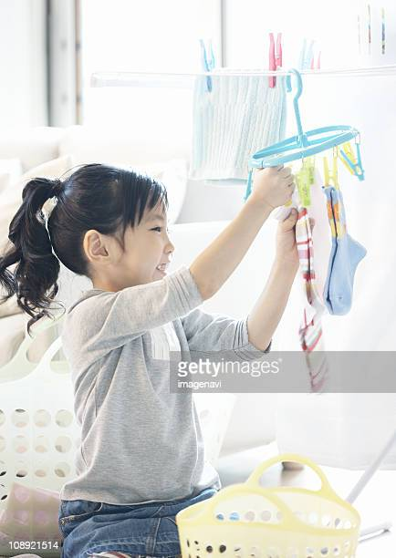 Girl hanging out the laundry