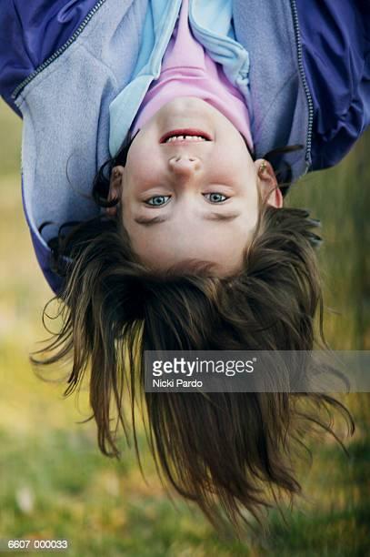 girl hanging upside down - 黒髪 ストックフォトと画像