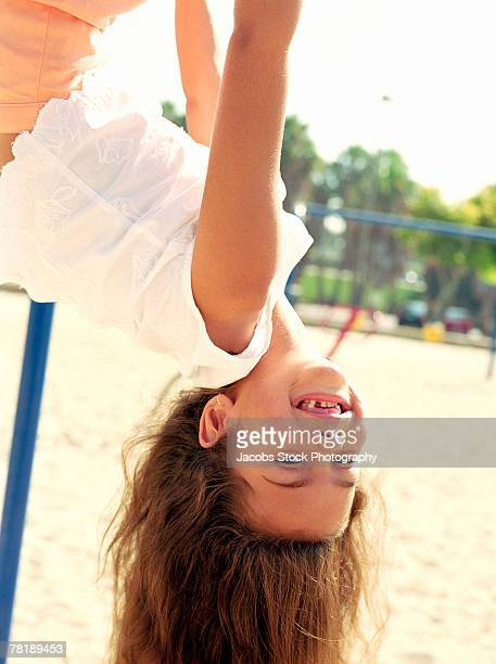 girl hanging upside down - down blouse stock photos and pictures