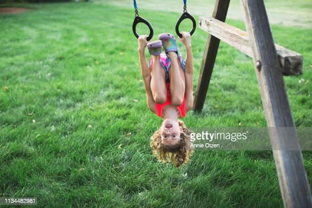 girl hanging upsidedown - day 6 stock-fotos und bilder