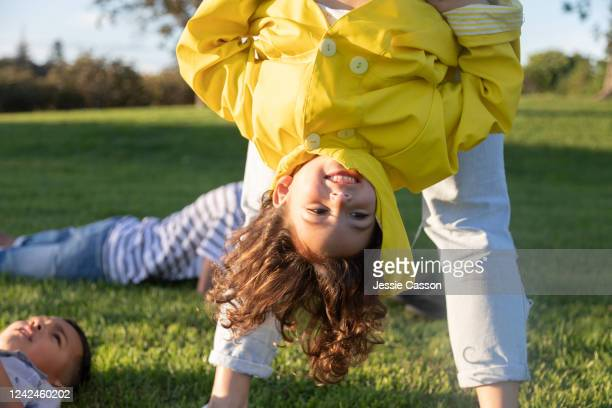 girl has fun being held upside down - nature reserve stock pictures, royalty-free photos & images