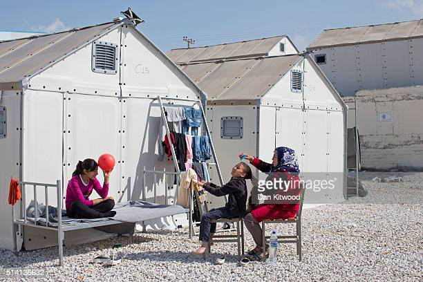 A girl has her hair brushed at the Diavata refugee relocation centre near Thessaloniki on March 07 2016 in Diavata Greece Relocation centres around...