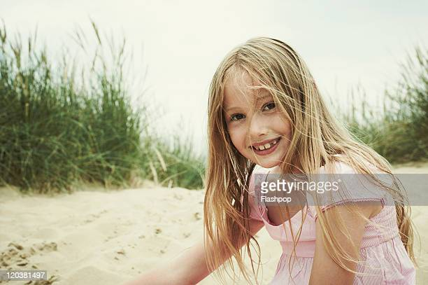 girl having a fun day out at the beach - innocence stock pictures, royalty-free photos & images