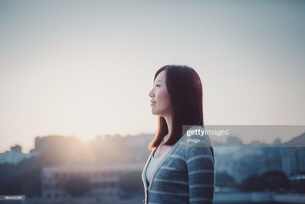 Girl having a refreshing breath in morning sunrise : Stock Photo