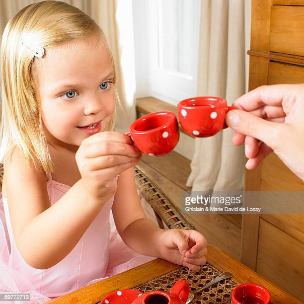 Girl having a tea time with her mother
